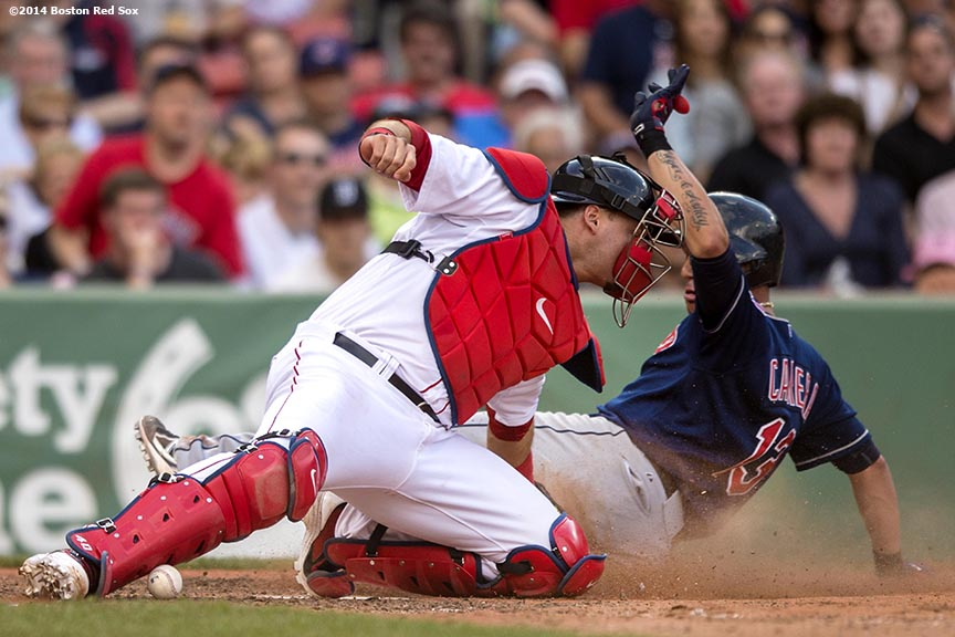 """Boston Red Sox catcher A.J. Pierzynski drops the ball as he tags shortstop Asdrubal Cabrera at home plate during the seventh inning of a game against the Cleveland Indians Saturday, June 14, 2014 at Fenway Park in Boston, Massachusetts."""