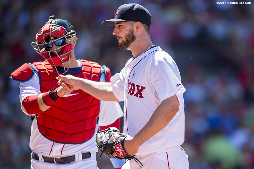 """Boston Red Sox catcher A.J. Pierzynski high fives pitcher Brandon Workman during the sixth inning of a game against the Cleveland Indians at Fenway Park in Boston, Massachusetts Sunday, June 15, 2014."""