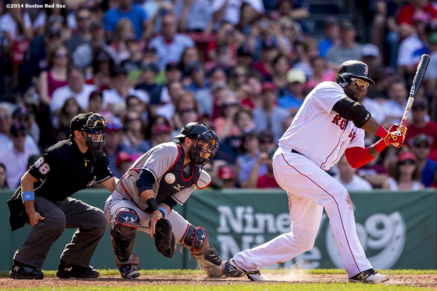 """Boston Red Sox designated hitter David Ortiz checks his swing as catcher Yan Gomes blocks the ball during the eighth inning of a game against the Cleveland Indians at Fenway Park in Boston, Massachusetts Sunday, June 15, 2014."""