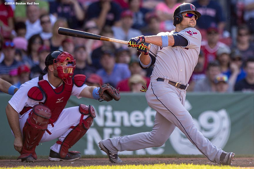 """Cleveland Indians first baseman Nick Swisher hits a game-winning home run in during the eleventh inning of a game against the Boston Red Sox at Fenway Park in Boston, Massachusetts Sunday, June 15, 2014."""