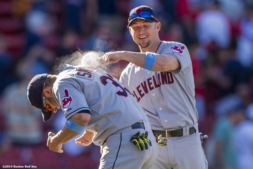 """Cleveland Indians first baseman Nick Swisher is brushed with a rosin bag as teammates celebrate defeating the Boston Red Sox 3-2 in eleven innings at Fenway Park in Boston, Massachusetts Sunday, June 15, 2014."""