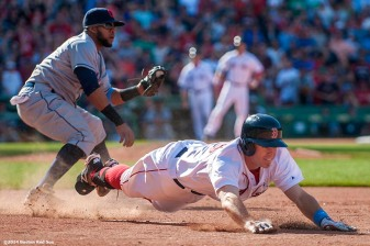 """Boston Red Sox third baseman Brock Holt dives through first base after attempting to beat out an infield hit during the ninth inning of a game against the Cleveland Indians at Fenway Park in Boston, Massachusetts Sunday, June 15, 2014."""