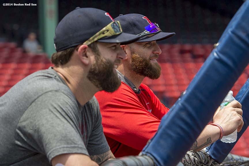 """Boston Red Sox left fielder Jonny Gomes and first baseman Mike Napoli watch as clients take batting practice during a Wise company corporate sponsorship appreciation event on the field at Fenway Park in Boston, Massachusetts Tuesday, June 17, 2014."""