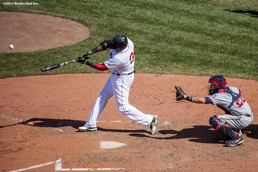 """Boston Red Sox designated hitter David Ortiz hits a game tying solo home run during the tenth inning of a game against the Minnesota Twins at Fenway Park in Boston, Massachusetts Tuesday, June 18, 2014."""