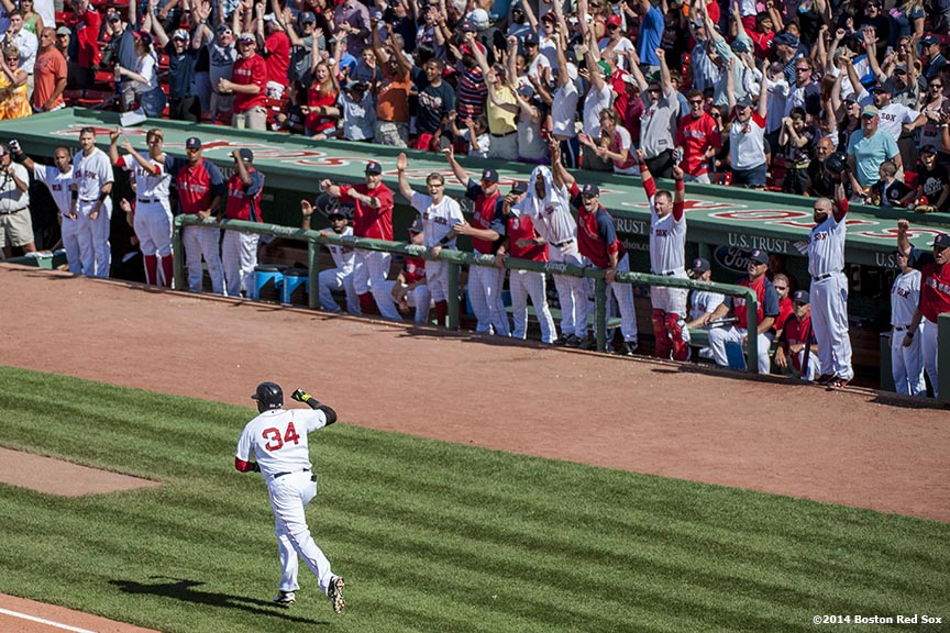 """Boston Red Sox designated hitter David Ortiz celebrates as he rounds first base after hitting a game tying solo home run during the tenth inning of a game against the Minnesota Twins at Fenway Park in Boston, Massachusetts Tuesday, June 18, 2014."""