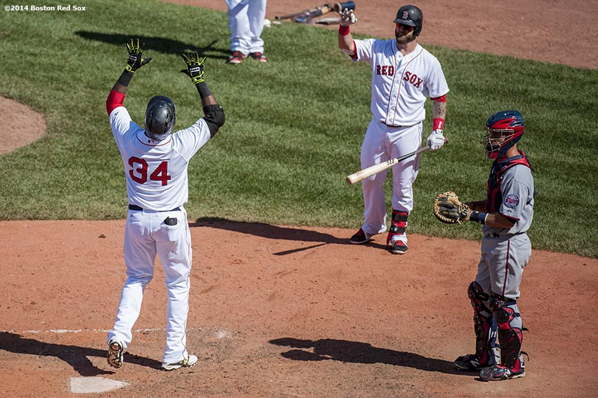 """Boston Red Sox designated hitter David Ortiz celebrates as crosses home plate after hitting a game tying solo home run during the tenth inning of a game against the Minnesota Twins at Fenway Park in Boston, Massachusetts Tuesday, June 18, 2014."""