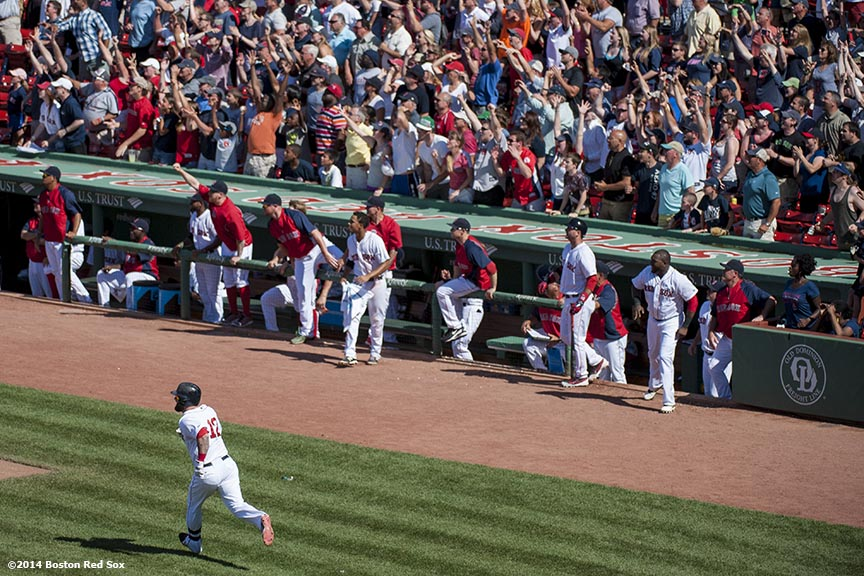 """Boston Red Sox players celebrate in the dugout as first baseman Mike Napoli hits a walk-off solo home run to defeat the Minnesota Twins 2-1 in the bottom of the tenth inning at Fenway Park in Boston, Massachusetts Tuesday, June 18, 2014."""