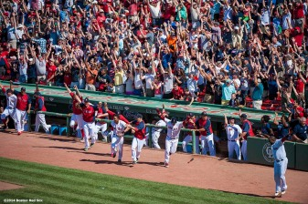 """Boston Red Sox players celebrate in the dugout after first baseman Mike Napoli hit a walk-off solo home run to defeat the Minnesota Twins 2-1 in the bottom of the tenth inning at Fenway Park in Boston, Massachusetts Tuesday, June 18, 2014."""