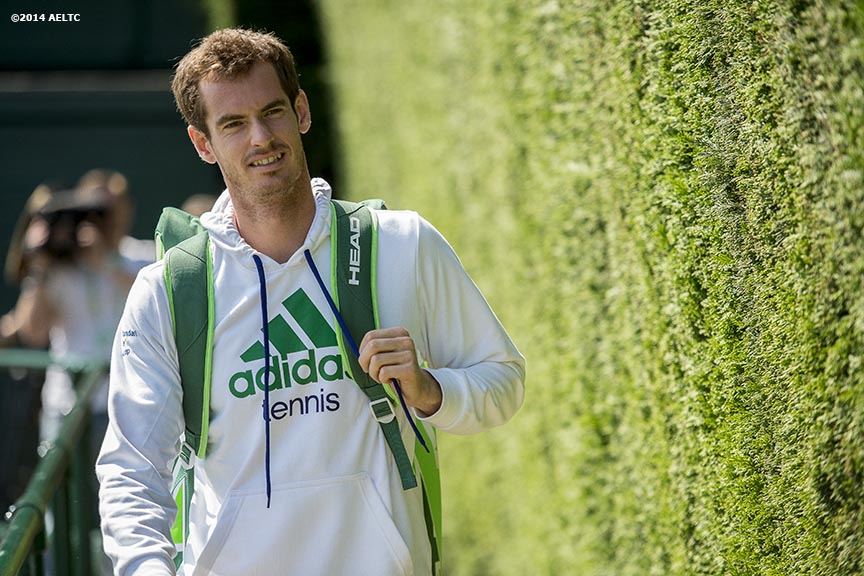 """Andy Murray walks toward the practice courts at the All England Lawn and Tennis Club in London, England Saturday, June 21, 2014 during the 2014 Championships Wimbledon."""