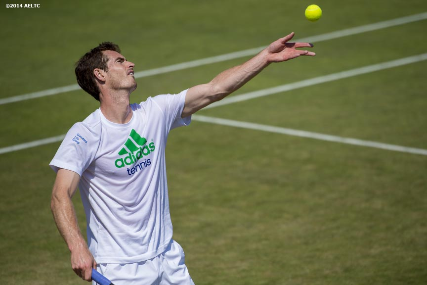 """Andy Murray serves during a practice session at the All England Lawn and Tennis Club in London, England Saturday, June 21, 2014 during the 2014 Championships Wimbledon."""