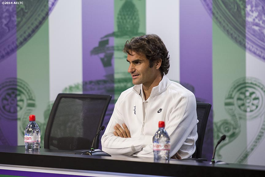 """Roger Federer addresses the media during a press conference at the All England Lawn and Tennis Club in London, England Saturday, June 21, 2014 during the 2014 Championships Wimbledon."""