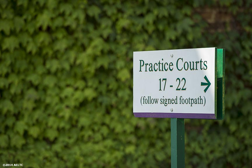 """A sign is displayed at the practice courts at the All England Lawn and Tennis Club in London, England Sunday, June 22, 2014 during the 2014 Championships Wimbledon."""