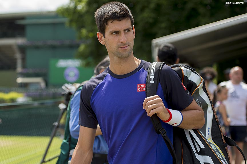 """Novak Djokovic walks toward the practice courts at the All England Lawn and Tennis Club in London, England Sunday, June 22, 2014 during the 2014 Championships Wimbledon."""