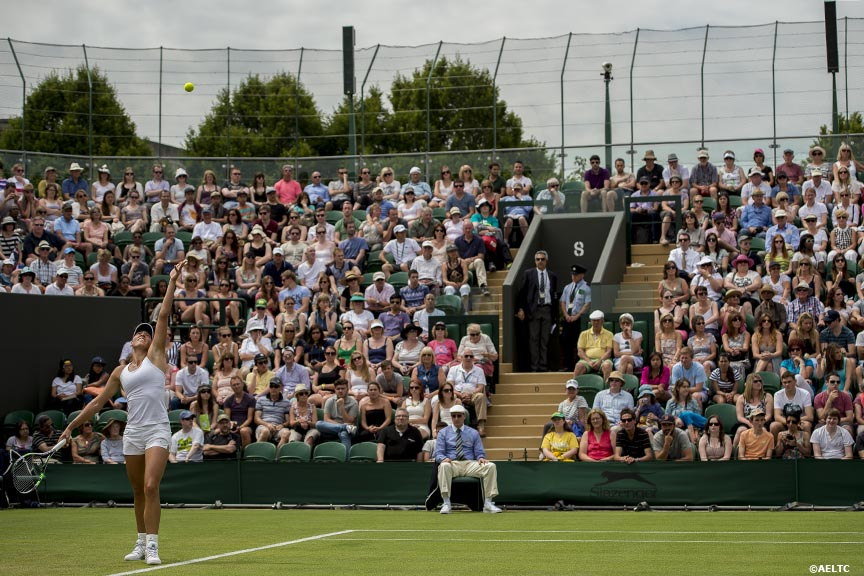 """Yanina Wickmayer serves during a match against Samantha Stosur at the All England Lawn and Tennis Club in London, England Monday, June 23, 2014 during the 2014 Championships Wimbledon."""