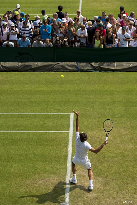 """Fans watch as Roger Federer practices at the All England Lawn and Tennis Club in London, England Tuesday, June 24, 2014 during the 2014 Championships Wimbledon."""