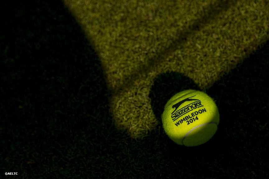 """A Slazenger Wimbledon 2014 tennis ball is shown at the All England Lawn and Tennis Club in London, England Tuesday, June 24, 2014 during the 2014 Championships Wimbledon."""