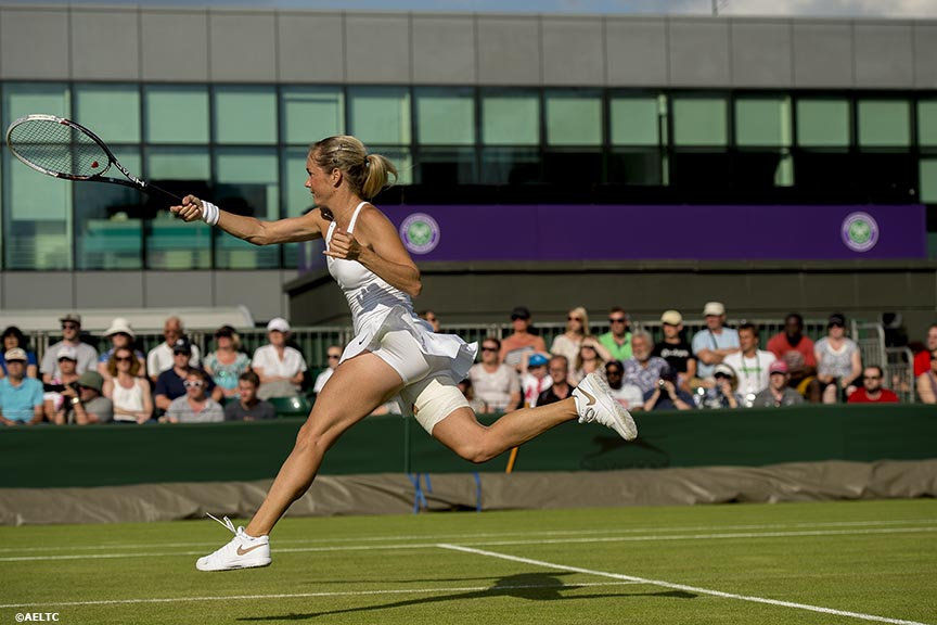 """Klara Koukalova leaps as she hits a forehand during a match against Taylor Townsend at the All England Lawn and Tennis Club in London, England Tuesday, June 24, 2014 during the 2014 Championships Wimbledon."""