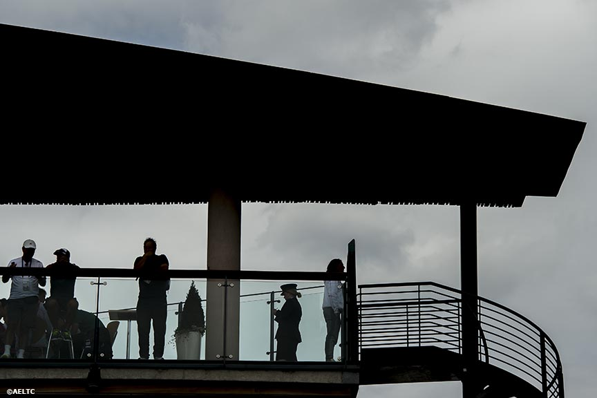 """Fans look over a balcony at the All England Lawn and Tennis Club in London, England Thursday, June 26, 2014 during the 2014 Championships Wimbledon."""