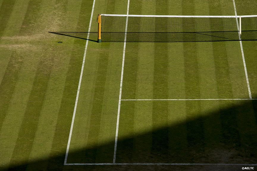 """A shadow falls across the grass on No. 1 Court at the All England Lawn and Tennis Club in London, England Friday, June 27, 2014 during the 2014 Championships Wimbledon."""