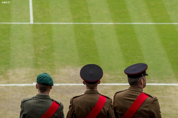 """""""Military personnel stand in front of Centre Court at the All England Lawn and Tennis Club in London, England Saturday, June 28, 2014 during the 2014 Championships Wimbledon."""""""