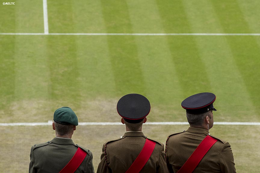 """Military personnel stand in front of Centre Court at the All England Lawn and Tennis Club in London, England Saturday, June 28, 2014 during the 2014 Championships Wimbledon."""