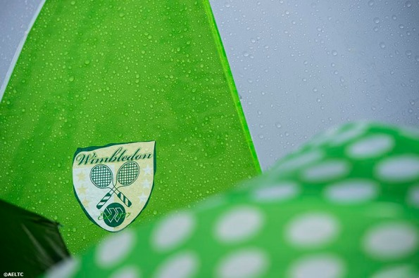 """""""Umbrellas are shown during a rain delay at the All England Lawn and Tennis Club in London, England Saturday, June 28, 2014 during the 2014 Championships Wimbledon."""""""