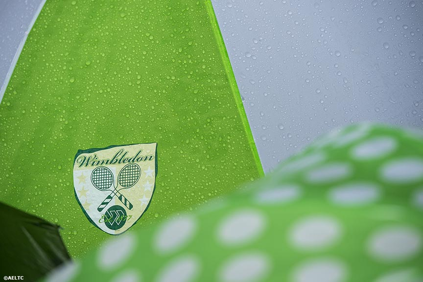 """Umbrellas are shown during a rain delay at the All England Lawn and Tennis Club in London, England Saturday, June 28, 2014 during the 2014 Championships Wimbledon."""
