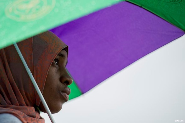 """""""A fan stands under an umbrella as she watches a match on Henman Hill at the All England Lawn and Tennis Club in London, England Saturday, June 28, 2014 during the 2014 Championships Wimbledon."""""""