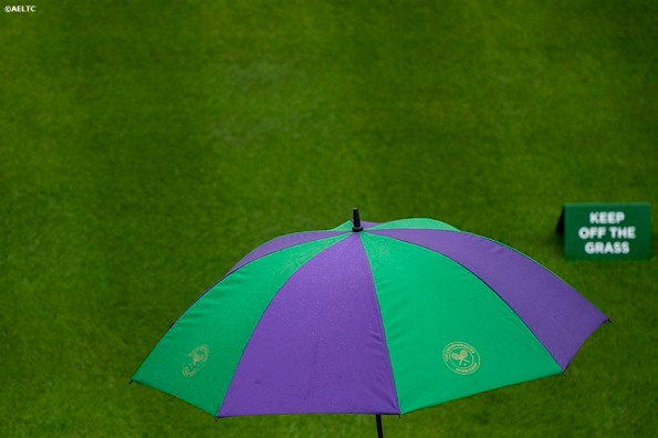 """""""An umbrella is shown during a rain delay at the All England Lawn and Tennis Club in London, England Saturday, June 28, 2014 during the 2014 Championships Wimbledon."""""""