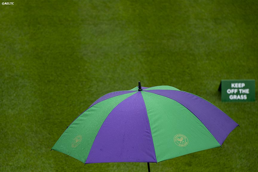 """An umbrella is shown during a rain delay at the All England Lawn and Tennis Club in London, England Saturday, June 28, 2014 during the 2014 Championships Wimbledon."""