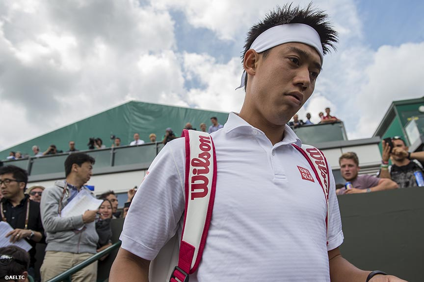 """Kei Nishikori enters Court 8 before a match against Simon Bolelli at the All England Lawn and Tennis Club in London, England Monday, June 30, 2014 during the 2014 Championships Wimbledon."""