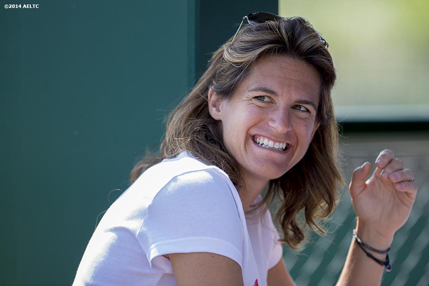 """Amelie Mauresmo, newly appointed coach of Andy Murray, smiles at the All England Lawn and Tennis Club in London, England Saturday, June 21, 2014 during the 2014 Championships Wimbledon."""