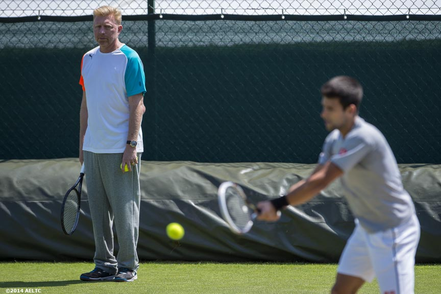 """Boris Becker watches as Novak Djokovic practices at the All England Lawn and Tennis Club in London, England Saturday, June 21, 2014 during the 2014 Championships Wimbledon."""