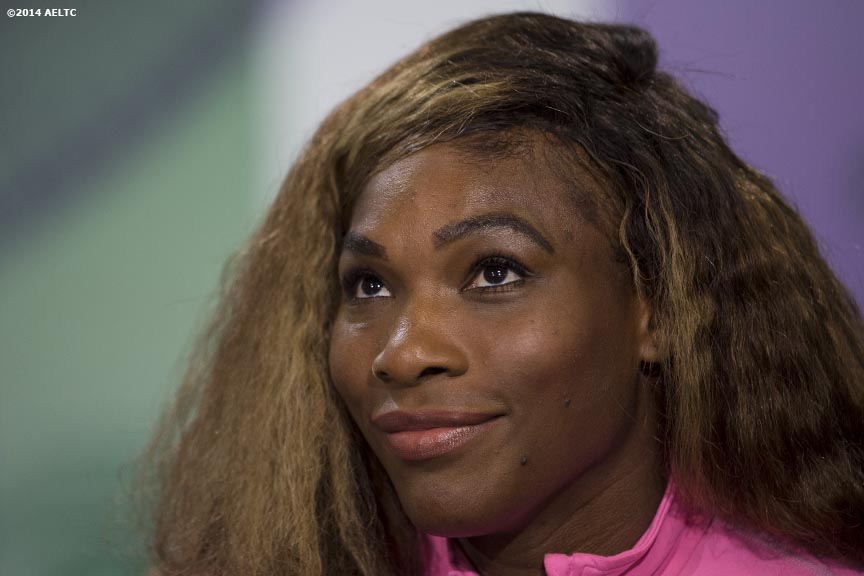 """Serena Williams reacts as she addresses the media during a press conference at the All England Lawn and Tennis Club in London, England Saturday, June 21, 2014 during the 2014 Championships Wimbledon."""