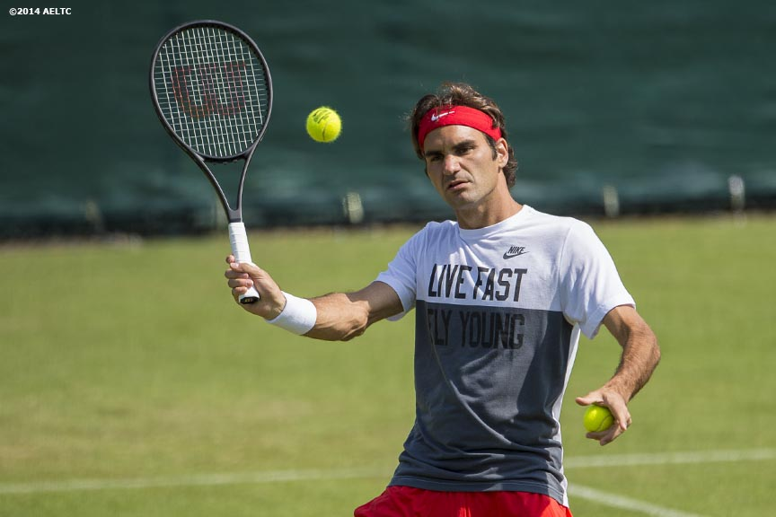 """Roger Federer hits a volley during a practice session at the All England Lawn and Tennis Club in London, England Sunday, June 22, 2014 during the 2014 Championships Wimbledon."""