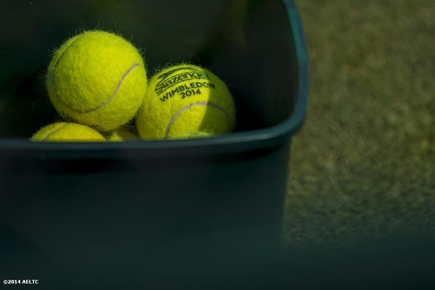 """Tennis balls are shown at the All England Lawn and Tennis Club in London, England Sunday, June 22, 2014 during the 2014 Championships Wimbledon."""