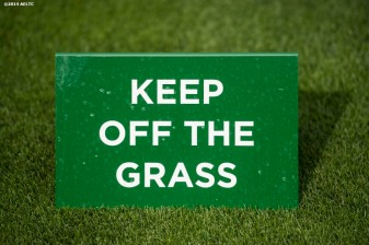 A sign that reads 'Keep Off The Grass' is shown at the All England Lawn and Tennis Club in London, England Sunday, June 22, 2014 during the 2014 Championships Wimbledon.""