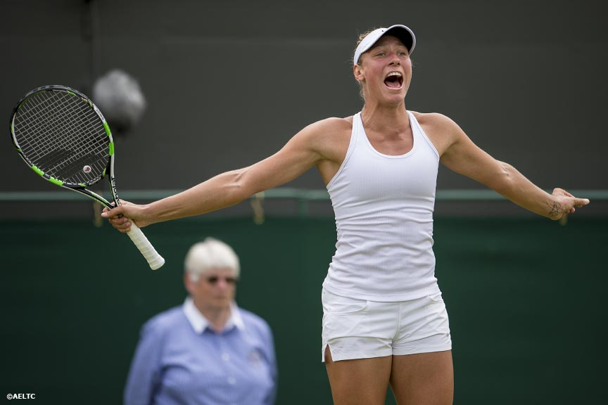"""Yanina Wickmayer celebrates after defeating Samantha Stosur at the All England Lawn and Tennis Club in London, England Monday, June 23, 2014 during the 2014 Championships Wimbledon."""
