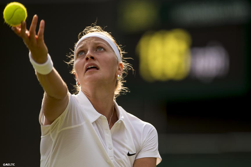 """Petra Kvitova serves to Andrea Hlavackova at the All England Lawn and Tennis Club in London, England Monday, June 23, 2014 during the 2014 Championships Wimbledon."""