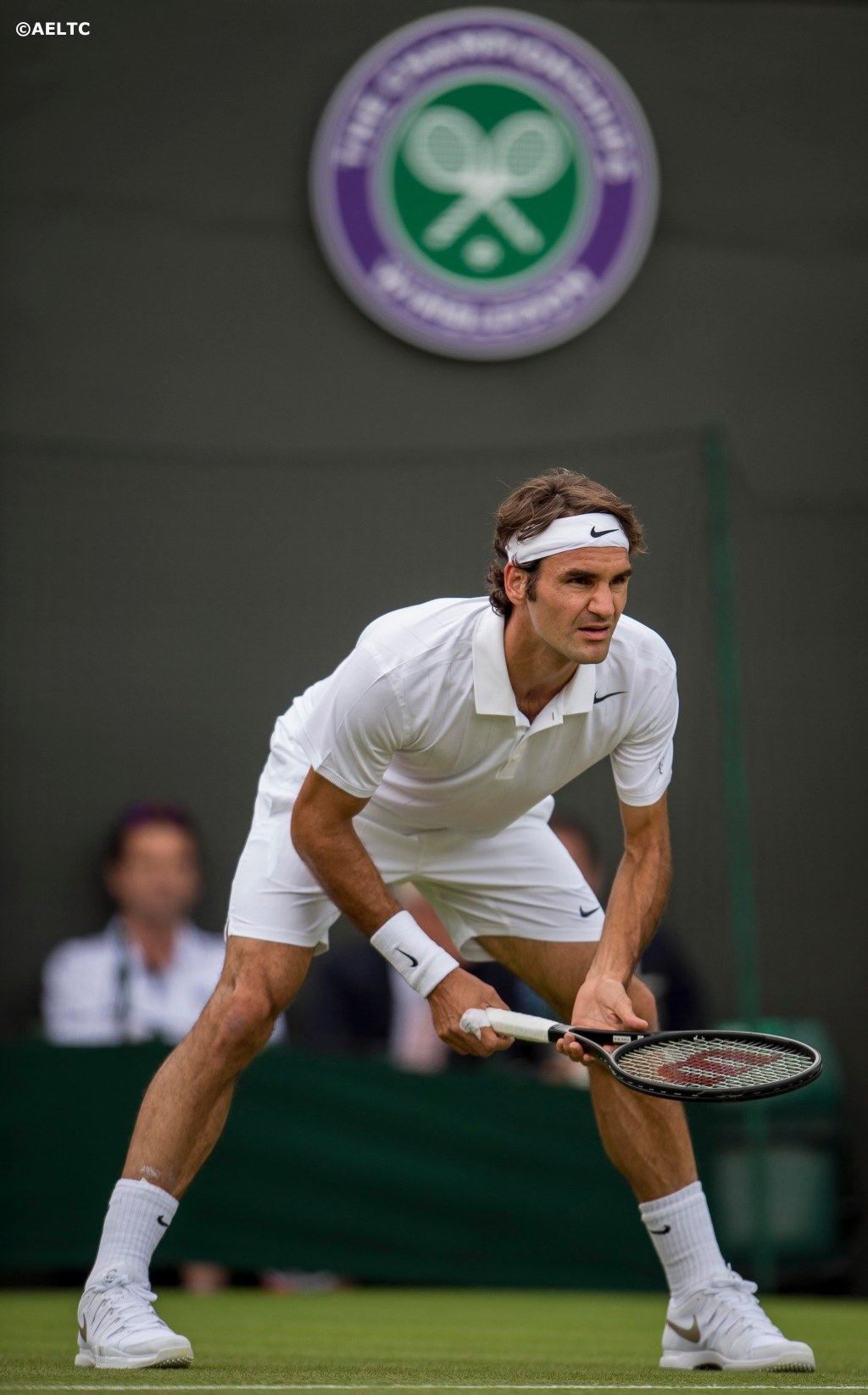 """Roger Federer prepares to return a serve during a match against Paolo Lorenzi on No. 1 Court at the All England Lawn and Tennis Club in London, England Tuesday, June 24, 2014 during the 2014 Championships Wimbledon."""