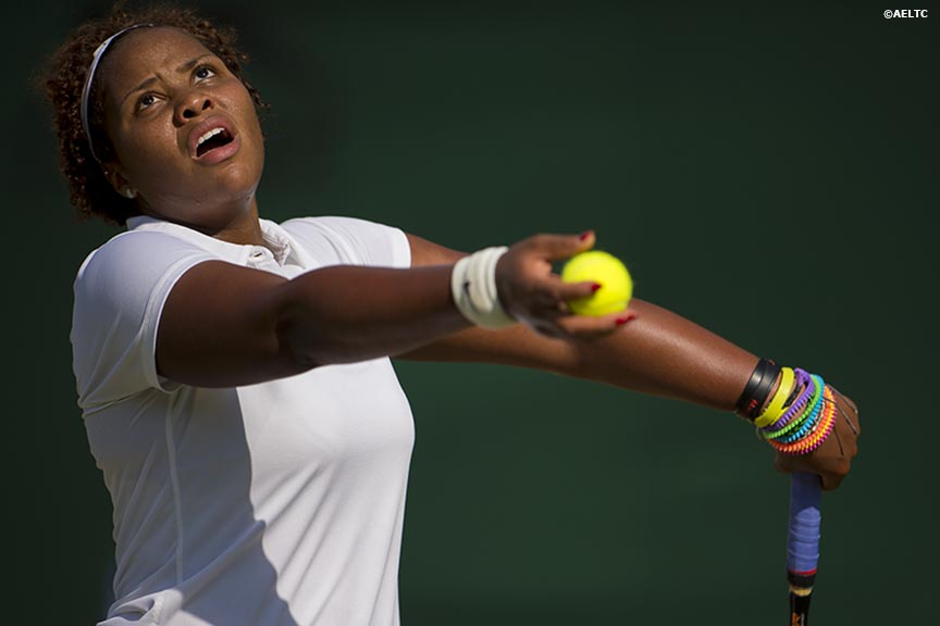 """Taylor Townsend serves during a match against Klara Koukalova at the All England Lawn and Tennis Club in London, England Tuesday, June 24, 2014 during the 2014 Championships Wimbledon."""