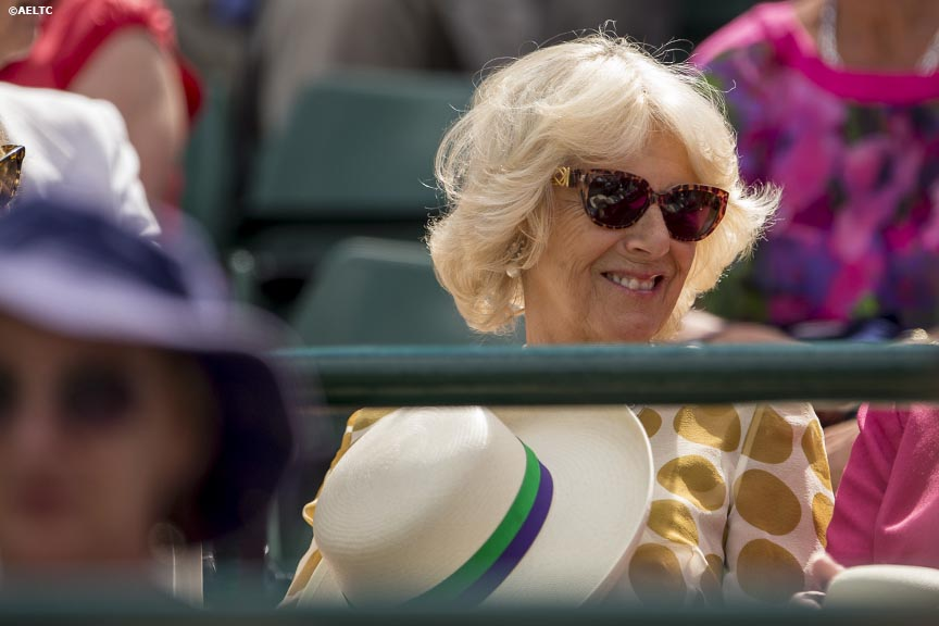 """Camilla, Duchess of Cornwall, watches a match on No. 1 Court at the All England Lawn and Tennis Club in London, England Tuesday, June 24, 2014 during the 2014 Championships Wimbledon."""