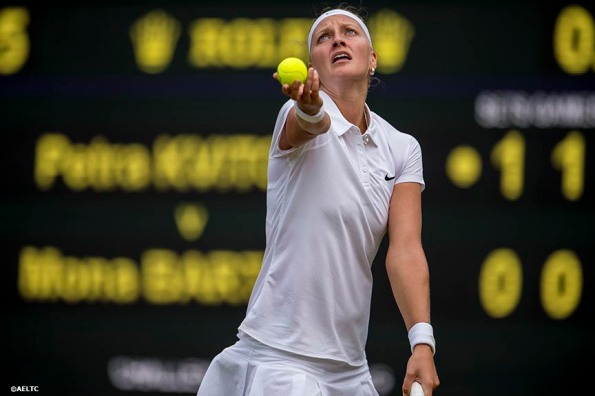 """""""Petra Kvitova serves during a match against Mona Barthel on No. 1 Court at the All England Lawn and Tennis Club in London, England Tuesday, June 24, 2014 during the 2014 Championships Wimbledon."""""""