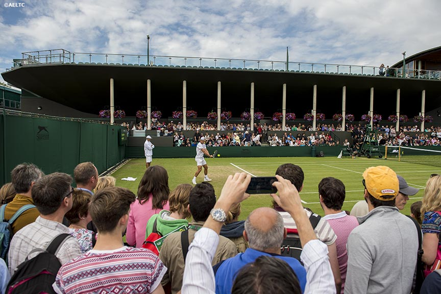 """Fans watch as Rafael Nadal practices at the All England Lawn and Tennis Club in London, England Thursday, June 26, 2014 during the 2014 Championships Wimbledon."""