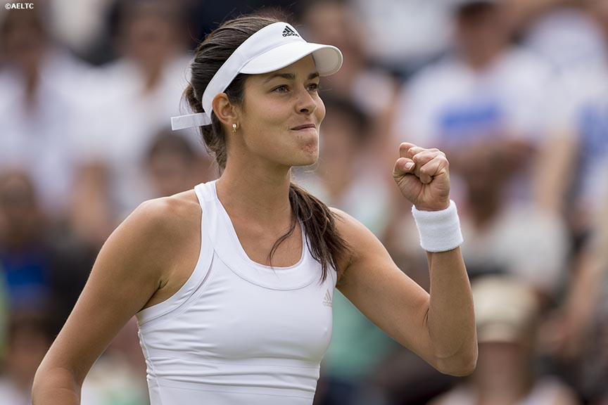 """Ana Ivanovic celebrates after defeating Jie Zheng at the All England Lawn and Tennis Club in London, England Thursday, June 26, 2014 during the 2014 Championships Wimbledon."""