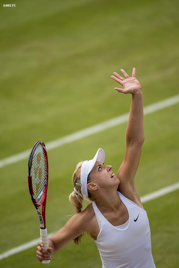 """Sabine Lisicki serves during a match against Karolina Pilskova at the All England Lawn and Tennis Club in London, England Thursday, June 26, 2014 during the 2014 Championships Wimbledon."""