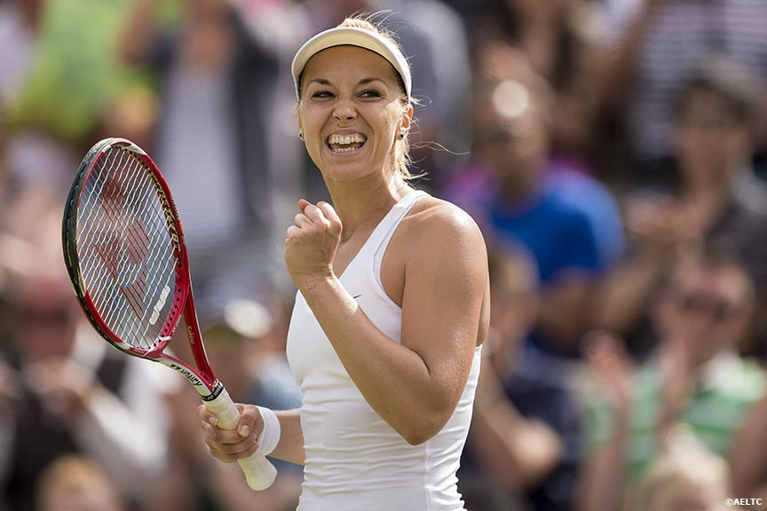 """Sabine Lisicki celebrates after defeating Karolina Pilskova at the All England Lawn and Tennis Club in London, England Thursday, June 26, 2014 during the 2014 Championships Wimbledon."""