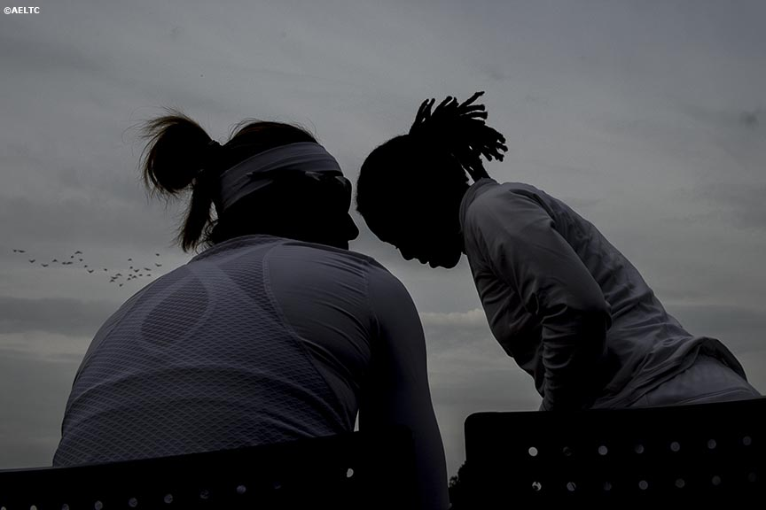 """Darija Jurak and Megan Moulton-Levy (USA) chat before a doubles match against Su-Wei Hsieh and Shuai Peng at the All England Lawn and Tennis Club in London, England Thursday, June 26, 2014 during the 2014 Championships Wimbledon."""