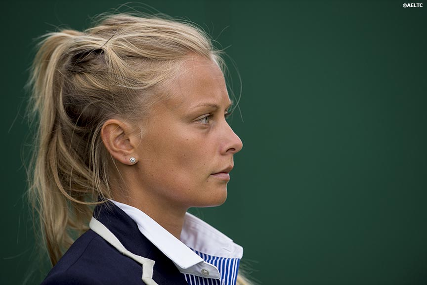 """A line judge looks across court at the All England Lawn and Tennis Club in London, England Thursday, June 26, 2014 during the 2014 Championships Wimbledon."""