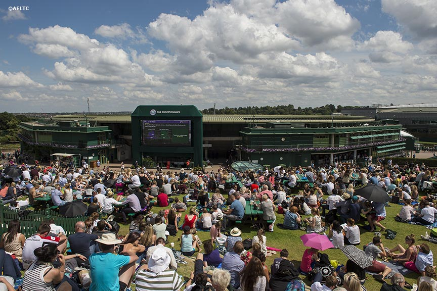 """Fans sit on Henman Hill at the All England Lawn and Tennis Club in London, England Friday, June 27, 2014 during the 2014 Championships Wimbledon."""